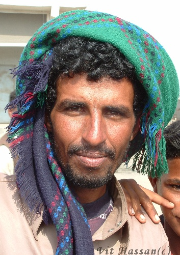 A middle-eastern man wearing a turban
